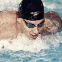 Speedo Pure Focus Mirror competition goggles worn by a Speedo team champion as he swims with a butterfly