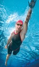 Model wears Arena Carbon Glide swimwear